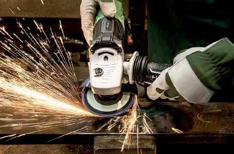 A man angle grinding